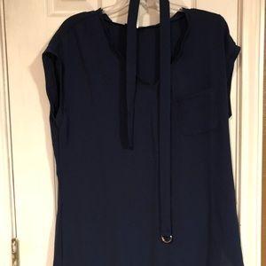 Blue short sleeve shirt with belt.